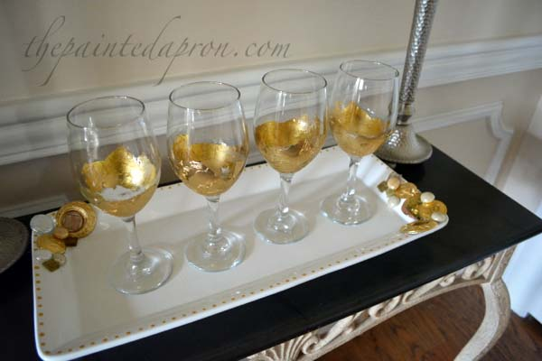 gold leaf wine glasses on a bejeweled tray