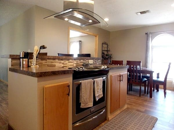 A Kitchen island with stove and range allows the cook to face the family, not the wall.