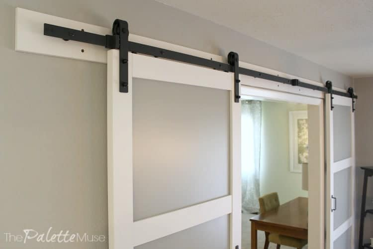 Modern barn doors with frosted glass and matte black farmhouse style hardware