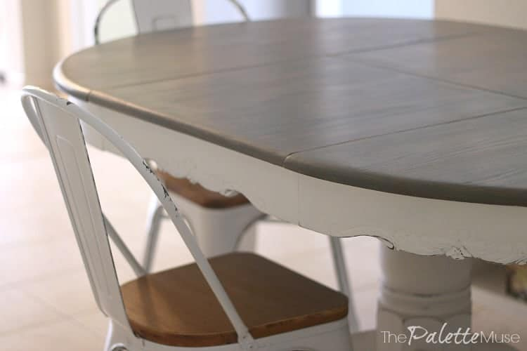 This farmhouse table used to be covered with deteriorating black enamel!