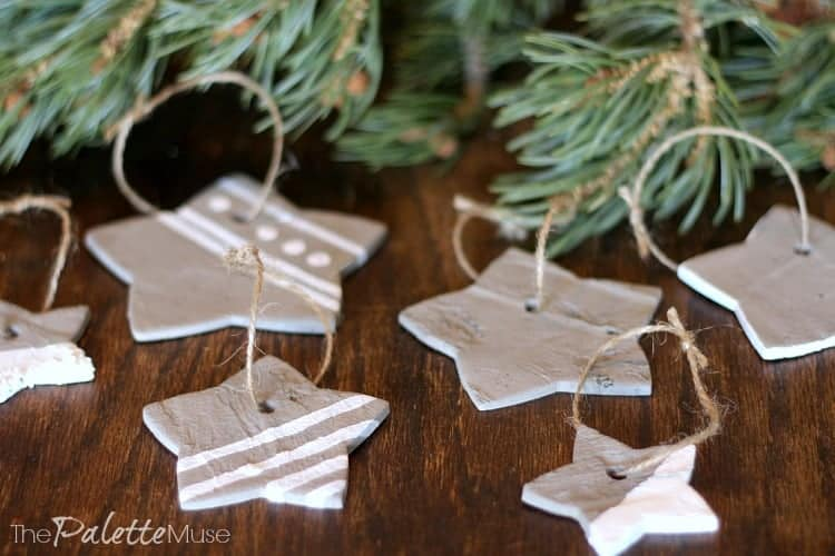 Concrete star ornaments painted with white accents, ready to hang on the tree