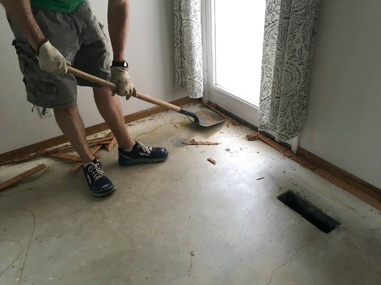 Removing carpet tack strips with a shovel