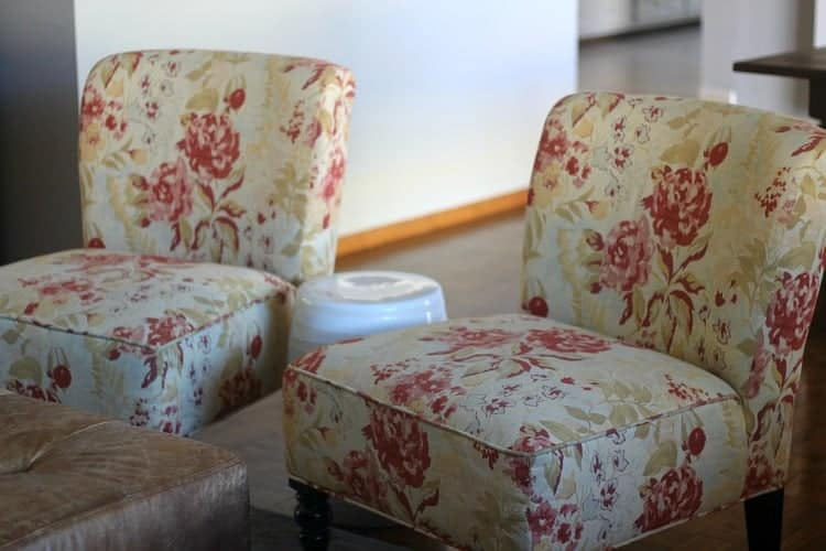 Occasional chairs in cream and antique rose pattern