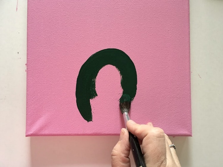 Start the cactus painting with arches, then fill them in.