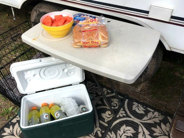 Set up a small table for organizing camping supplies.