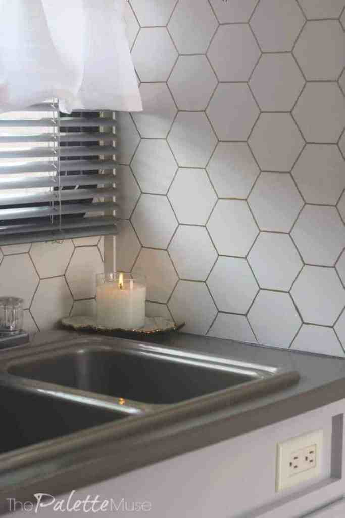 Camper Makeover Reveal - gold hex backsplash.