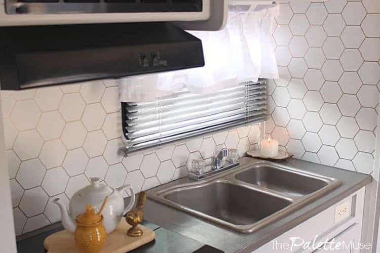 Gold hexagons on white background backsplash