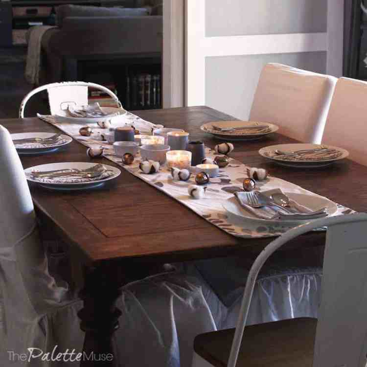 Warm candlelight gives this simple tablescape a cozy feel.