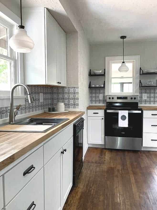 Bright white kitchen with wood floors and butcher block counter tops.