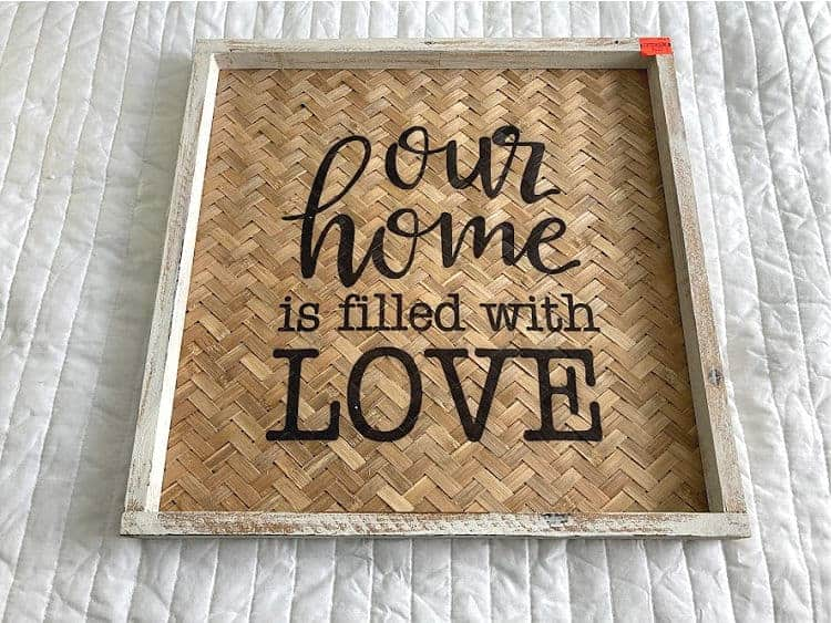 """Framed print says """"Our Home is Filled with Love"""""""