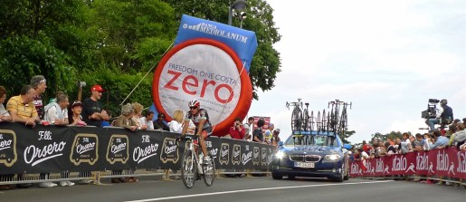 Lone rider leads the team car - Giro d'Italia 2013   ©Tom Palladio Images