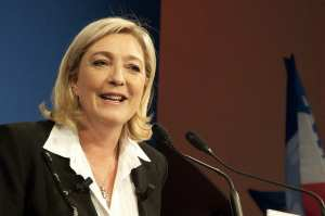Marine Le Pen charged for sharing photos  of IS extremists