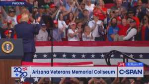 Trump gives a World War 2 Vet a signed MAGA hat during rally