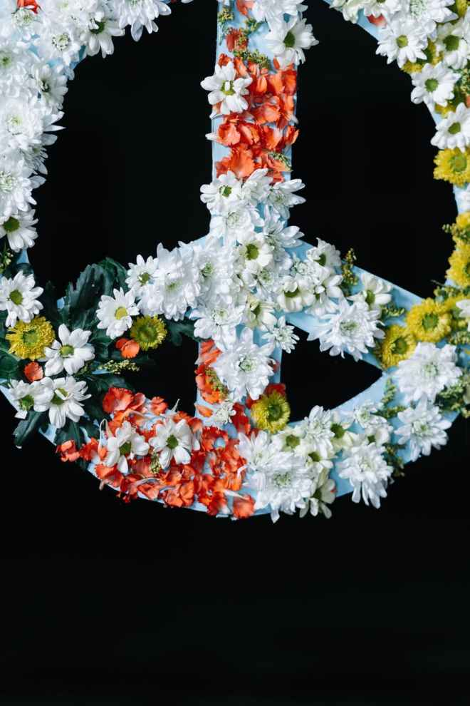 peace sign banner covered in flowers