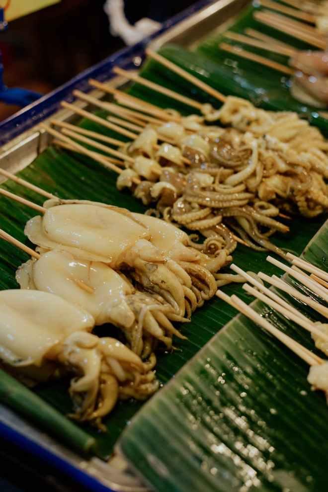 raw squid on barbecue sticks