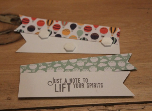 Use dimensionals to hold the banner pieces together and pop them up. The words are from Lift Me Up and the paper is from Carried Away, the free sale-a-bration choice that you can have with a $60 purchase in Canada.