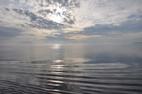 The sun started to peek through the clouds, and the water was smooth as glass. What an incredible sight!