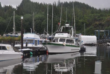The rain lets up as we return to the dock, giving me another opportunity to enjoy the boats and reflections.