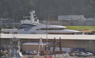 This huge yacht was at the dock, and that's a fishing boat in the foreground.