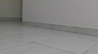 Floors are tile with tile baseboards. If you don't want tile or can't afford it, you can have the basic cement floor. If you want something fancier you can have wood floors and/or carpets, but in this damp humid climate I think the tile makes more sense.