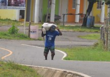 As we drove away from the hotel we saw this man walking up the road with a heavy bag on his shoulders.