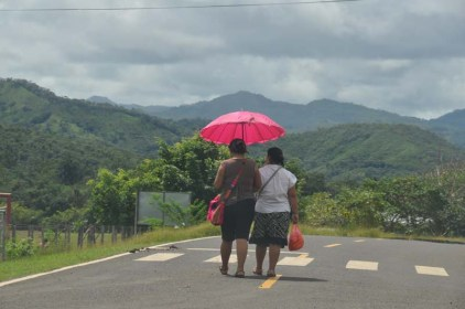 Panamanians are concerned about skin health, and they don't want to get any darker so umbrellas for sun protection are very common.