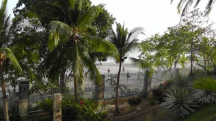 There was a volley ball game in progress on the beach below.