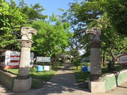 The city park with interesting pillars at the corner.