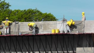 The workers with their yellow shirts remind me of worker bees. I was glad to see that they always had safety equipment when they were working. I don't think I ever saw anyone up there who wasn't fastened to something to protect them in case of a fall.