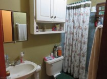 """The bathroom is across the hall. There is hot water by """"suicide shower"""", a typical Panamanian on demand water heater so named because it runs by electricity."""