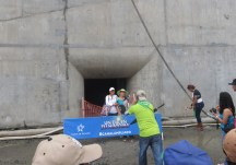 There were various spots for photos. Here a staff member is taking a photo for these folks in front of one of the spaces where the water goes in and out of the lock. The sign says - A day in your history.