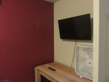 There is a desk area and TV.