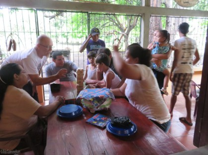 """After a meal of BBQ pork sandwiches, baked beans, and potato salad there was an exciting game of jenga with much cheering, hollering, and shouts of """"don't touch the table!"""""""