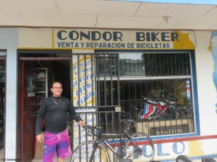 Condor in front of his shop.