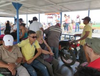 it was crazy, motorcycles, furniture, food, luggage, all sorts of things were loaded on the boat along with the people.