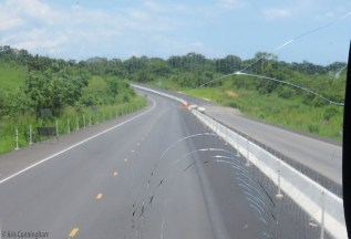 Parts of the highway look very good with both lanes paved, dividers in the middle, and even painted lane markers. A cyclist could ride on the almost finished new part.
