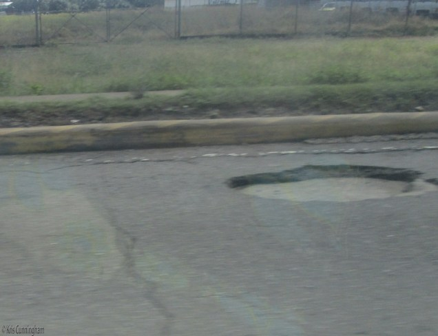 The highway also has more and more of these potholes. It looks like whole sections of asphalt have gone missing, exposing the concrete road below. People say the heavy rains are to blame for a lot of this.