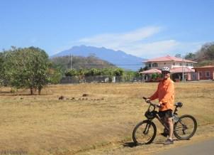 Joel stops in front of the view of Volcan Baru
