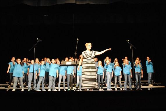 Director Debra Stroud doing a final bow with the junior high choir