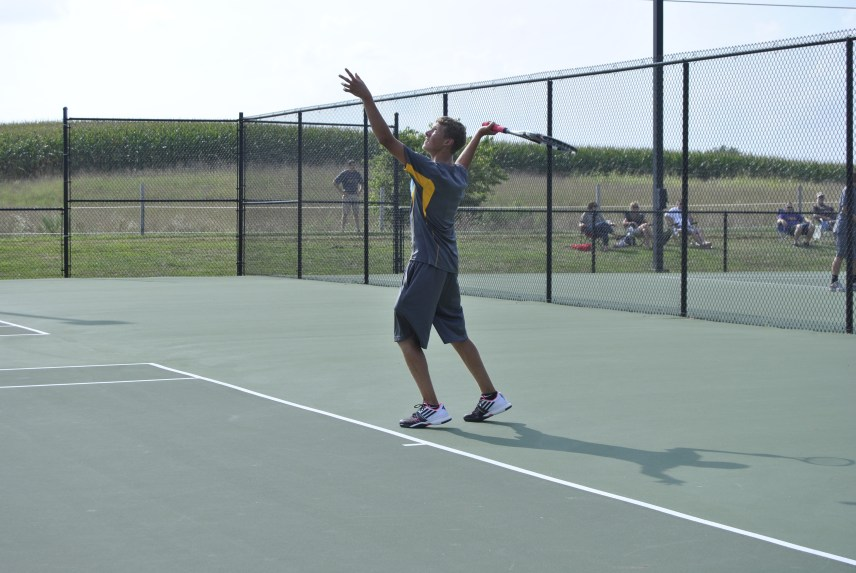 Senior Kyle Street serves the ball during a home tennis match.