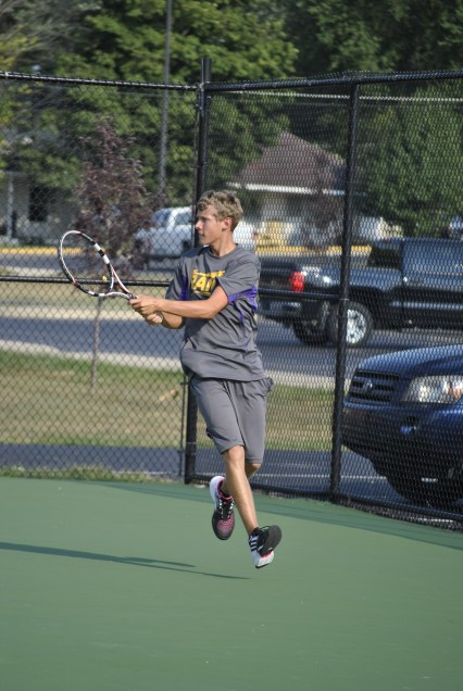 Senior Kyle Street runs to hit the ball back during a home match.