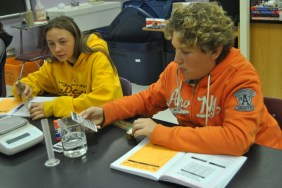 Eighth graders Koby Durbin and Joesy Bledsoe work together for a science experiment.