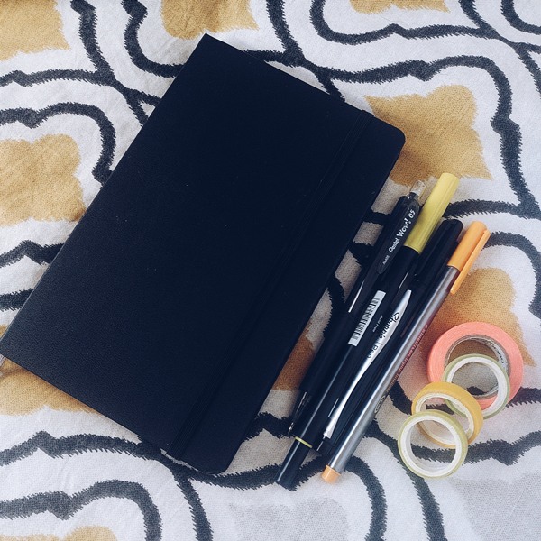 Image shows bullet journal and stationery items