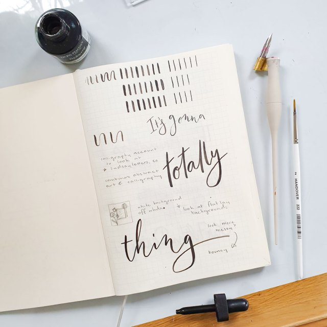 Calligraphy and hand lettering on notebook page.