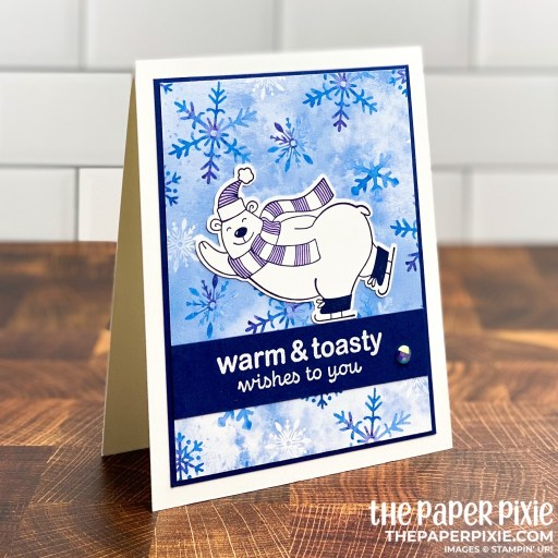 This is a handmade card stamped with the Warm and Toasty Stampin' Up! stamp set and the sentiment says warm and toasty wishes to you.