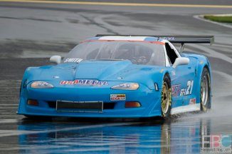 Dane Smith in his #21 GT-1 Corvette trying his best to find traction with slicks on a very wet race track.