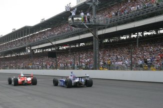 Sam Hornish Jr. takes the checkered flag just barely ahead of Marco Andretti to end the 90th running of the Indianapolis 500 in the second closest finish ever. -- Photo by: Leigh Spargur