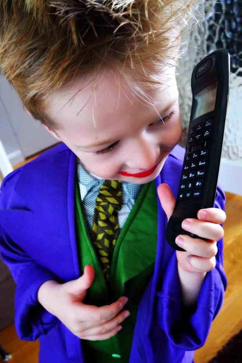 Little boy wearing lipstick talking on the phone
