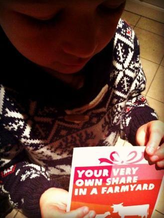 Little boy holding an Oxfam card