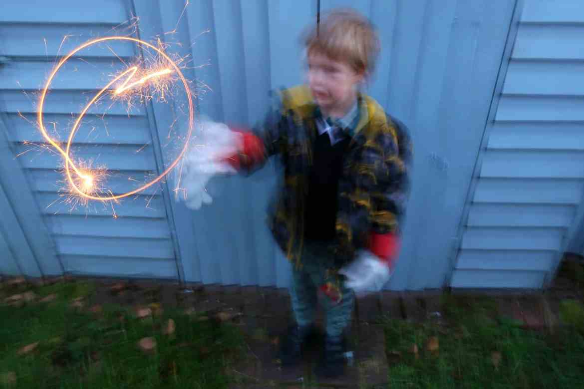 Bonfire night child playing with a sparkler
